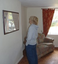 The Cheesmaker's House - Jane Cable studies the original lease in the dining room.